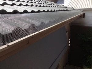 Gutters with All-flow gutterguard to protect house from leaf debris or burning embers