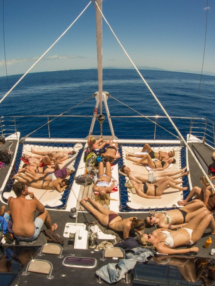 Cairns day trip - guests enjoying the front deck of Passions of Paradise