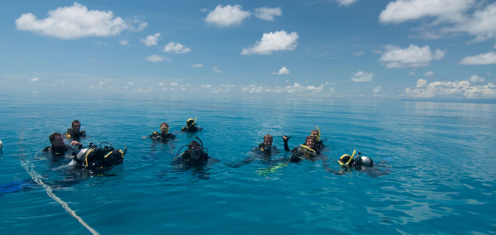 Cairns, learn to scuba dive - newly certified divers prepare to descend for open water dive